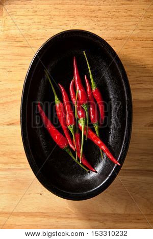 Red Chili Pepper on Wooden Tray