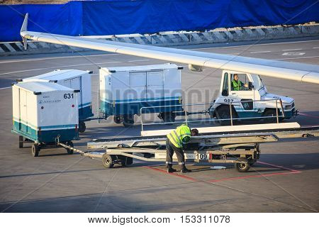 Moscow, Russia - May 27, 2016:   Luggage loading  before boarding  at the Domodedovo airport in Moscow, early morning