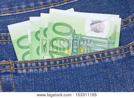 the European banknotes money in jeans pocket