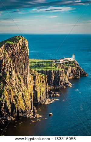 Breathtaking Dusk At The Neist Point Lighthouse In Isle Of Skye, Scotland