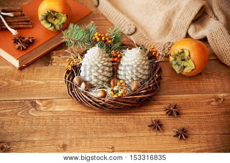 Candle Fir Cones On A Wooden Table