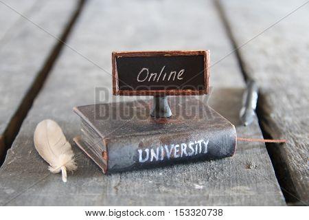 Book - computer and inscription university, vintage style. Online classes idea.