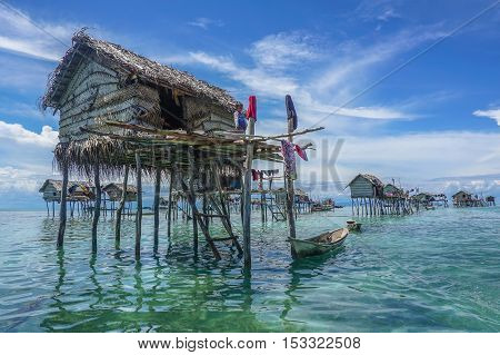 The traditional sea gypsy water village with the unique boat in Bodgaya Island at Semporna,Sabah Land Below The Wind.One of the main attraction of Semporna with clear blue water,sand & palm trees.