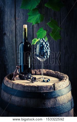 Red Wine On Barrel With Rape Grapes