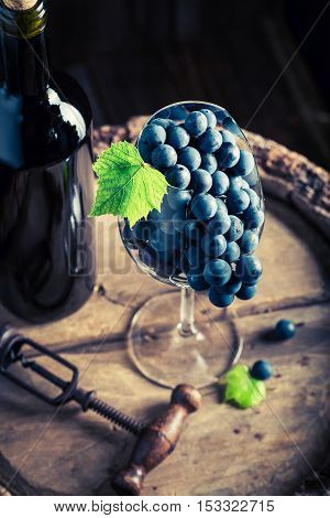 Fresh Red Grapes In Glass On Barrel
