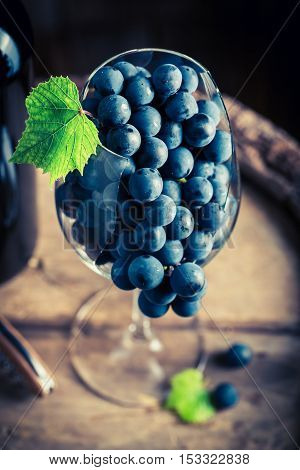 Tasty And Fresh Red Grapes In Glass