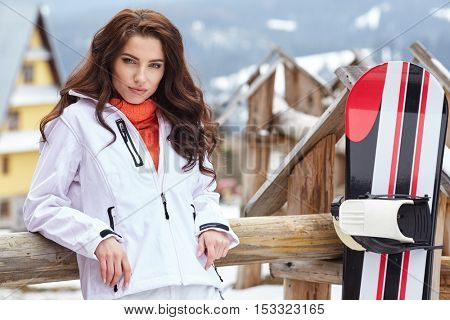 Woman snowboarder . winter day. Beautiful girl on snoborde in the snow.