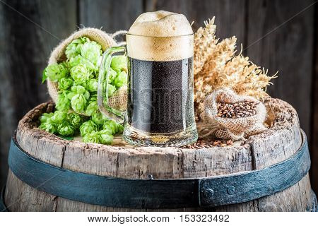 Fresh Dark Beer With Big Foam, Hops And Wheat