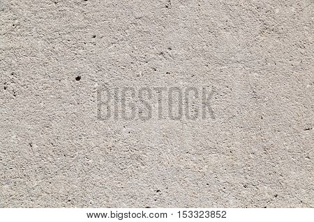 Plaster wall from executed from impressive plaster, on the basis of the invoice from a small stone, having gray color