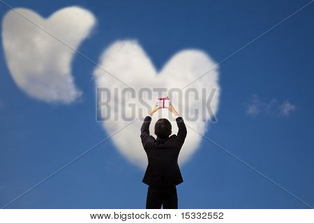 Man holding gift and two heart and love cloud