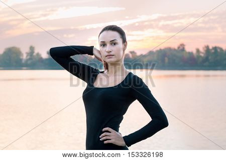Young Woman Portrait In Early Morning At Colorful Sunrise