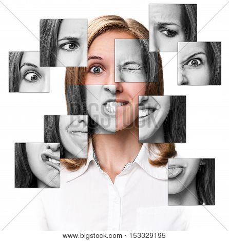 Collage of emotional woman face collected from different parts. Isolated on white