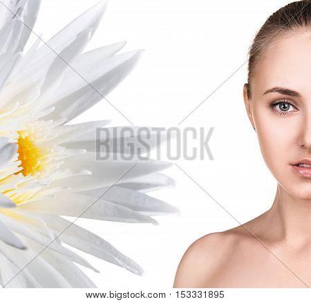 Beautiful woman half-face near white lotus flower. Beauty concept