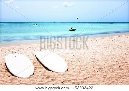 Surfboards on Palm Beach on Aruba island in the Caribbean Sea