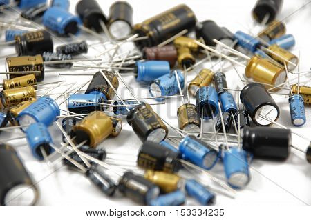 Lots of different capacitors on white background