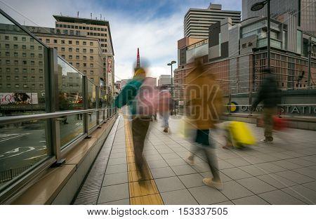 OSAKA, JAPAN - FEB 9: Pedestrians at Osaka Station in Osaka, Japan on Febuary 9, 2015. Osaka Station is a major railway station in the Umeda district of Kita-ku.