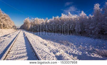 Frozen Railway Line In Winter At Sunrise