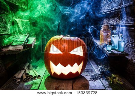 Spooky pumpkin for Halloween party on old wooden table