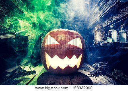 Spooky Halloween Pumpkin With Blue And Green Smoke