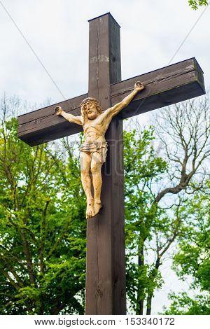 Crucifix - Crucified Jesus Christ hanging on the cross roadside