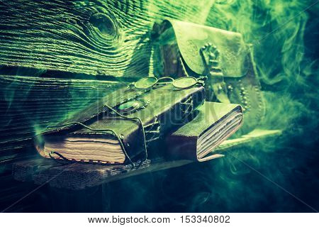Vintage Witcher Cottage With Green Light And Books For Halloween