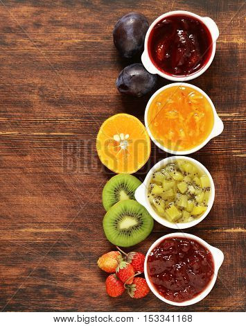 Assorted berries and fruit jams. Homemade canning. Fresh berries and fruits