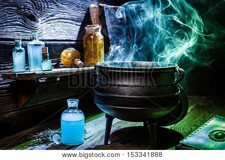 Vintage Witcher Cauldron With Blue Smoke And Potions For Halloween