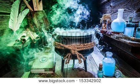 Full Of Magic Mixture In Witch Hut With Books And Blue Potions For Halloween