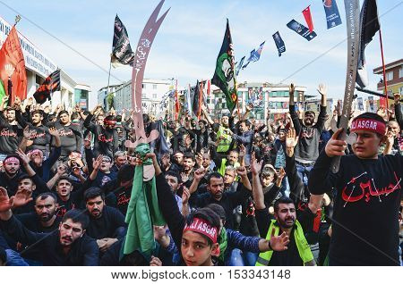 Istanbul Turkey - October 11 2016: Shia Muslim men shout Islamic slogans as they mourn during an Ashura procession. Turkish Shia Muslims mourning for Imam Hussain. Caferis take part in a mourning procession marking the day of Ashura in Istanbul's Kucukcek
