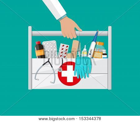 Mediacal first aid kit in doctors hands with different pills and medical devices, Pill and care healthy, healthcare. vector illustration in flat style isolated on green background