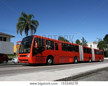 daytime photo articulated bus used in Curitiba