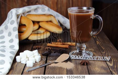 cocoa with bagels and an inscription good morning