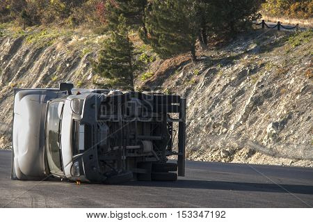 car truck overturned on the road due to strong wind