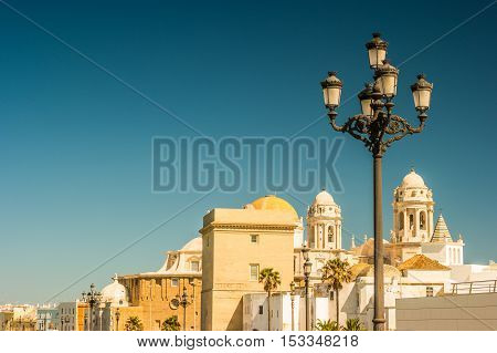 Beautiful view of Cadiz with cathedral and Iglesia Santa Cruz. Bright travel picture of sunny Andalusia.