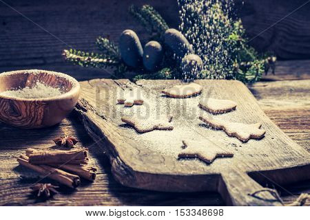 Decorating With Icing Sugar Christmas Cookies On Wooden Table