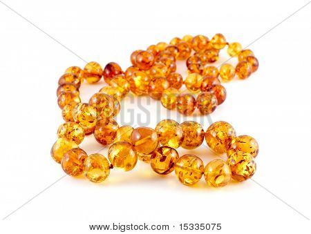 close-up of amber beads isolated on white