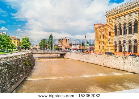 View at cityscape in town Sarajevo located on famous river Miljacka, Bosnian and Herzegovina capital, Europe.