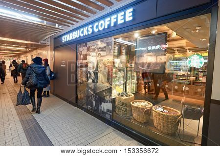 HONG KONG - CIRCA JANUARY, 2016: Starbucks in Hong Kong. Starbucks Corporation is an American coffee company and coffeehouse chain