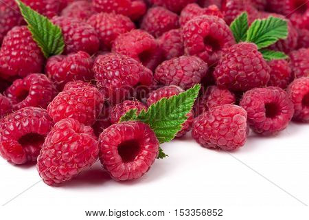 many raspberries isolated on a white background.