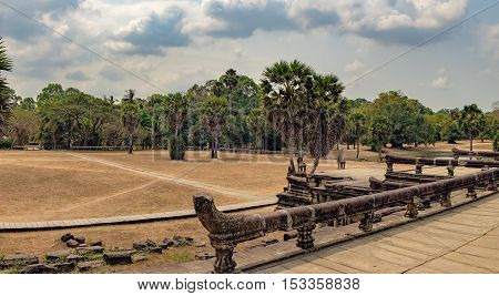Naga serpent cobra king Vasuki in the foreground guards the main road to the Angkor Wat temple Siem Reap Cambodia.