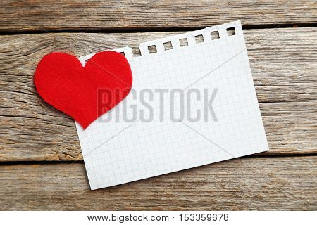 Red Heart And Sheet Of Blank Paper On A Grey Wooden Table