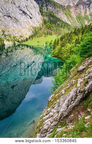 Beautiful Obersee lake wih mirror reflection in Alps Germany