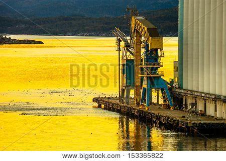 Grain terminal at sunrise in the port of Stavanger Norway.