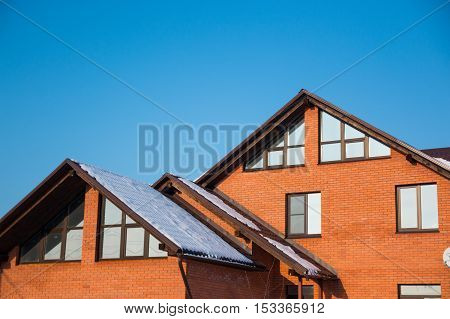 the roof of the house with nice window in winter
