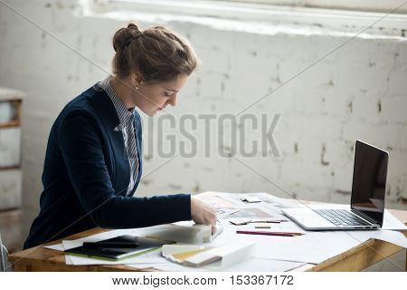 Female Designer At Workplace
