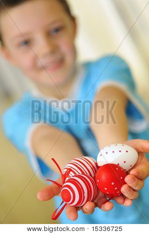 easter kid with colorful eggs