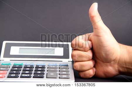 Man touching calculator on an isolated background