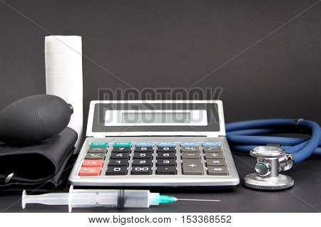 calculator and medical equipment on a surface