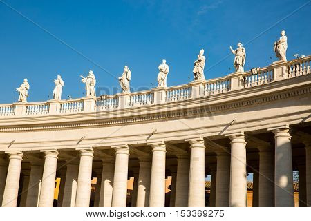 St. Peter's Square, Vatican, Rome, Italy View of the colonnade with statues of saints surrounding St. Peter's Square