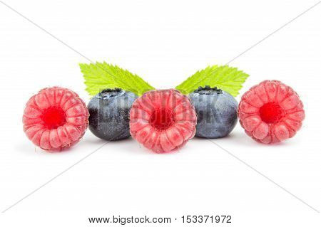 some fresh blueberries and raspberry in row isolated on white background.